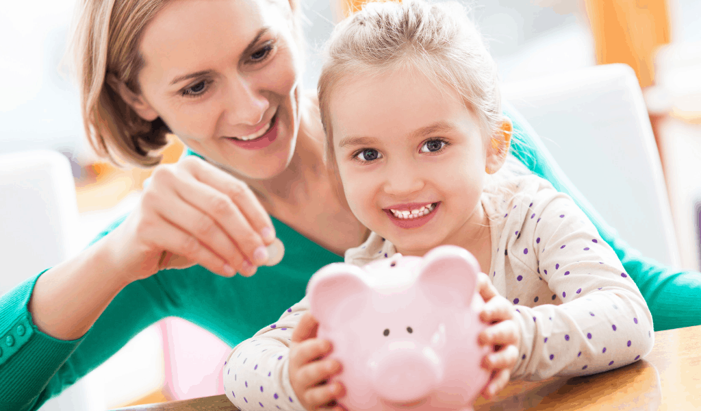 woman and child putting money in piggy bank