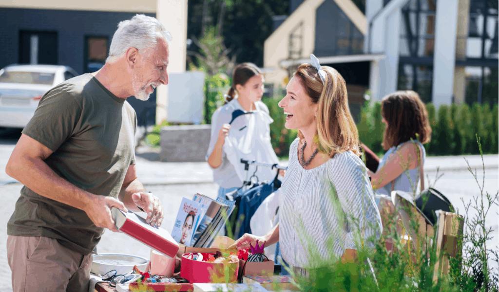 man and woman talking at a yard sale