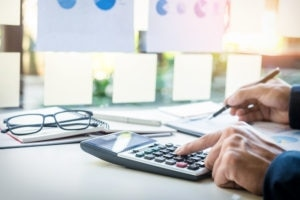 Business Finance Man Calculating Budget Numbers Invoices And Financial Adviser Working