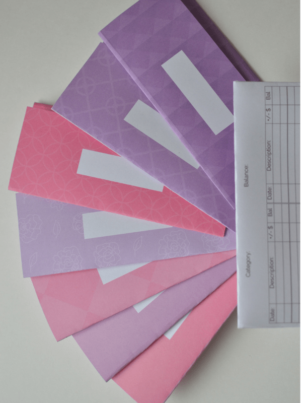 pink and purple cash envelopes with a blank one