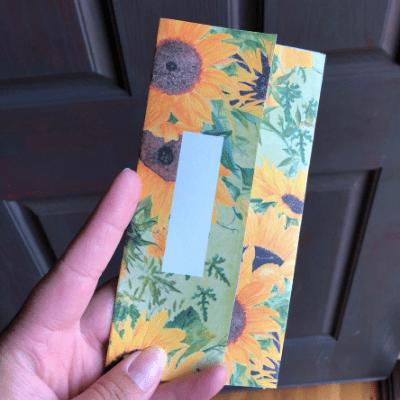 holding sunflower envelope