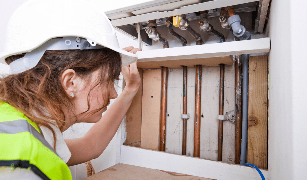 female plumber making repairs