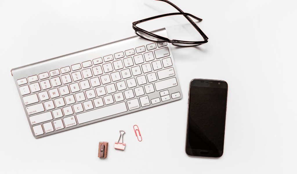 keyboard with phone and sunglasses