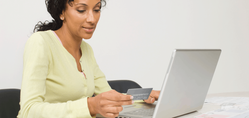 woman paying collections online with a credit card