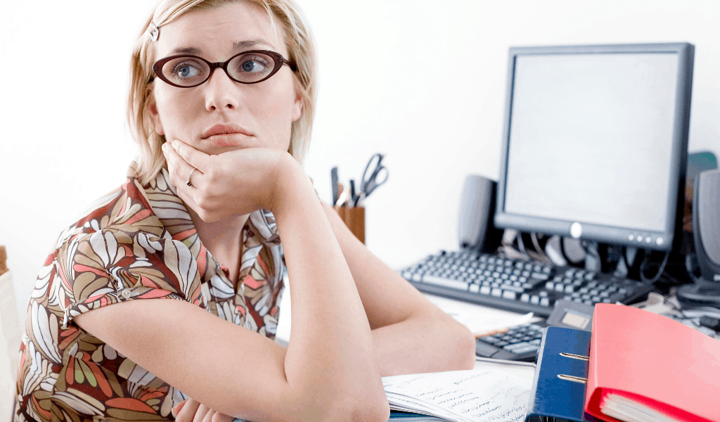 working woman worrying at her desk about a recession