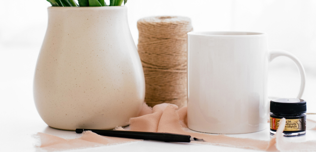 white vase and coffee mug