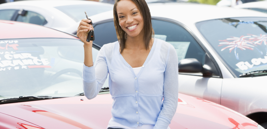 buying a new car is a money myth that can cost you thousands! Black female holding the keys to a new car
