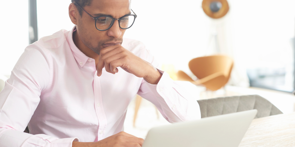 Black male working on laptop