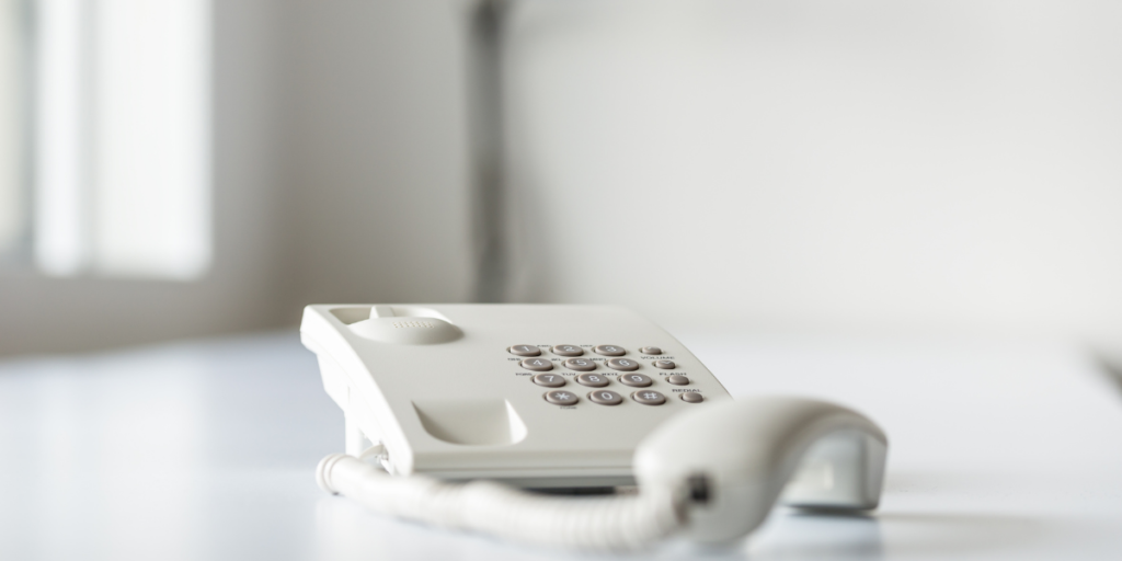 white landline home phone used for free internet