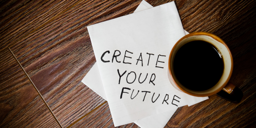 A cup of coffee with a paper stating create your future reminding you to change your money mindset and secure your financial future.