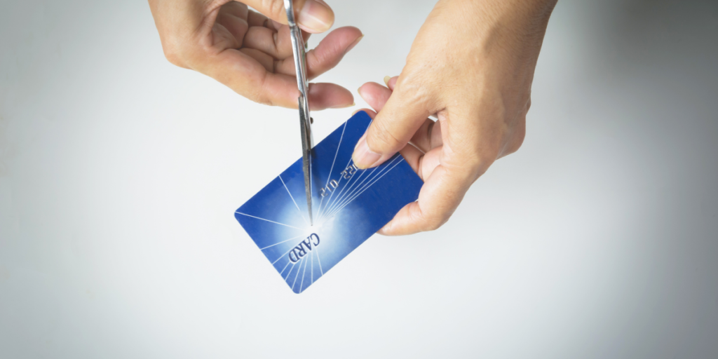 Cutting up credit cards and slashing expenses when you change your money mindset to secure your future and finances.