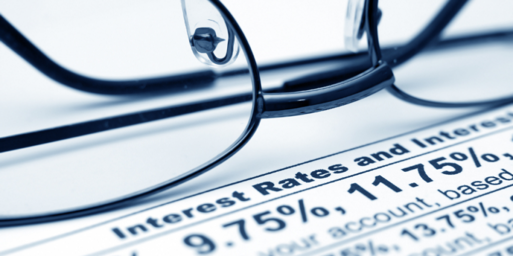 watching interest rates, investing and paying off debt