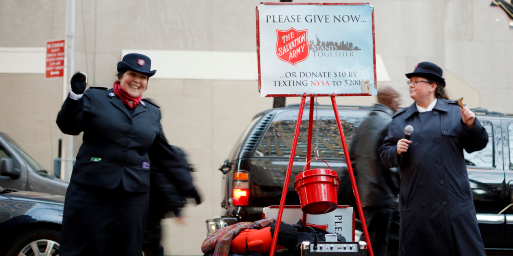 salvation army bell ringers raising money for free christmas gifts