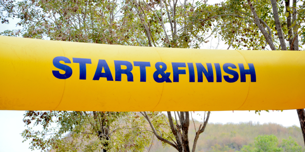 A yellow start & finish line for changing money mindset and securing a financial future.