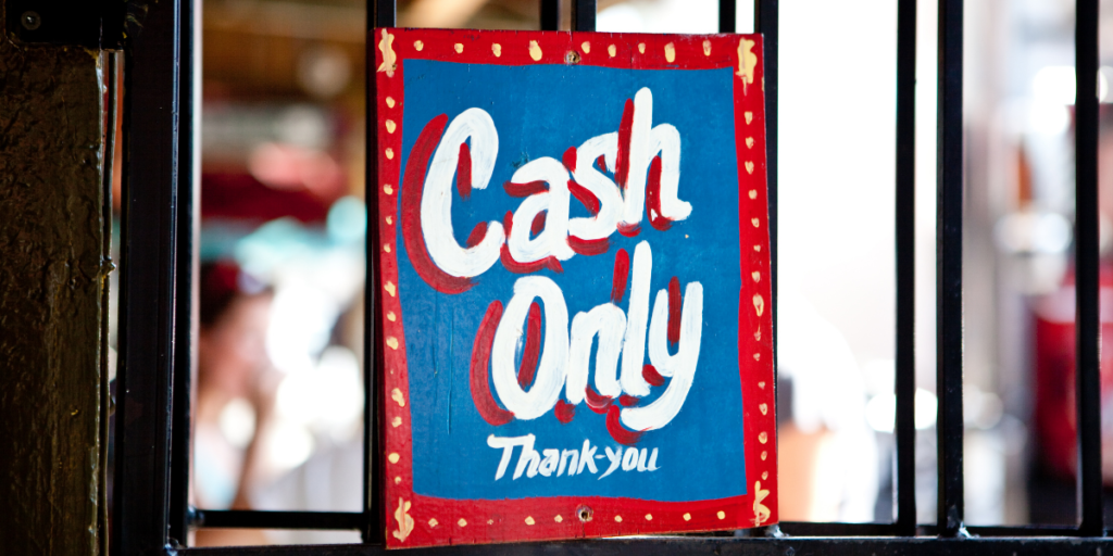 "A store sign that say ""Cash Only Thank -you"" which can help one stick to their budget by using cash."