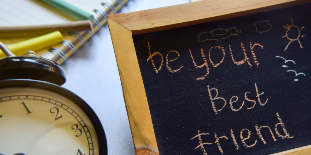 "A clock sitting beside a chalkboard sign with ""Be your best friend"" written on it as a cue to stick to your budget."