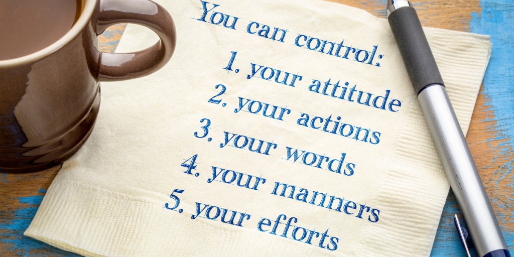 "A cup of coffee next to a napkin on a table with a pen and the napkin has the words ""You can control: your attitude, your actions, your words, your manners, your efforts"" when it comes to reaching your financial goals."