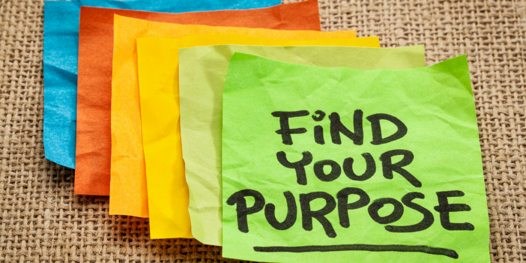 Several colorful post-it notes laying on burlap with the top one showing Find Your Purpose and in turn that will help one stay motivated.