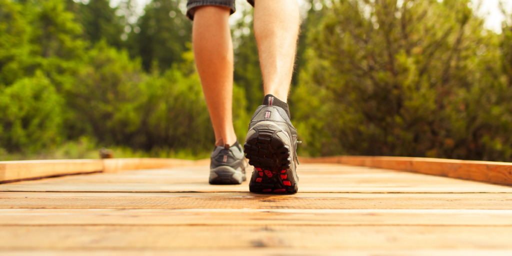A person taking a walk because a lack of physical movement can keep hinder one from staying motivated.