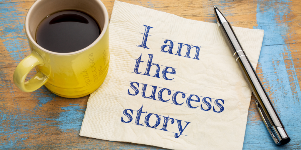 """""""I am the success story"""" printed on a napkin laying beside a pen and a yellow cup of coffee reminding us that we are the creators of our success and how we can hustle without money upfront."""