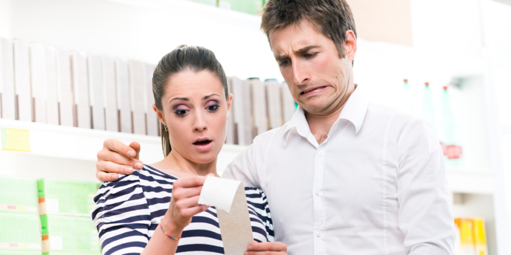 Couple reviewing the receipt for their dreaded grocery budget purchases.