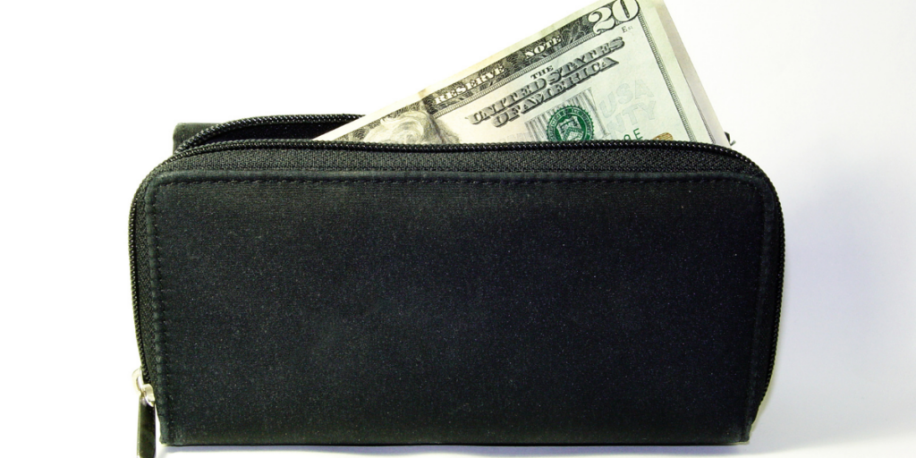A black wallet with money sticking out.