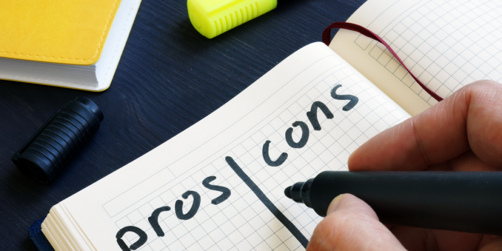 The start of a pros and cons list in a notebook.