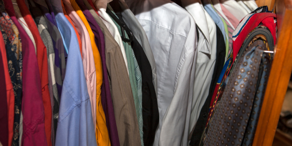 A closet with clothing - one of the four basic human needs vs wants.