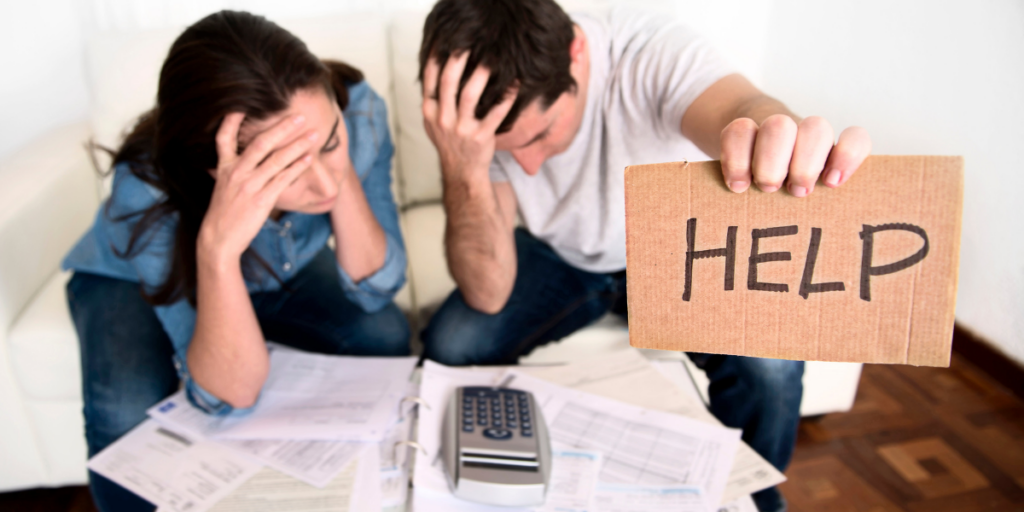 A couple in financial crisis asking for help with going over their budget to determine needs vs wants.